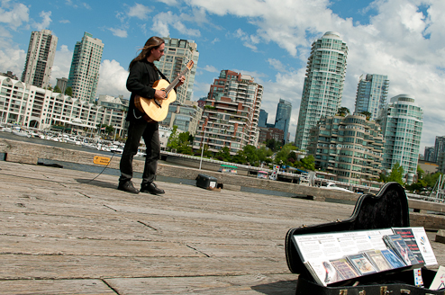 Les Finnigan, an award-winning, local guitarist performs regularly for visitors to Granville Island.
