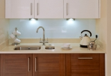 Installing lighting in key work areas can improve your kitchen inexpensively
