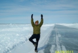"Sheena doing the ""tree pose"" on the frozen Arctic Ocean."