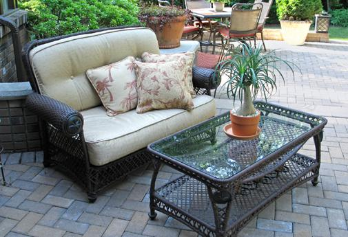 Recovered cushions and pretty plants can transform your patio space quickly