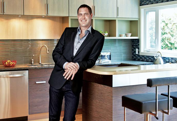 Mark Workman relaxes in his newly renovated kitchen