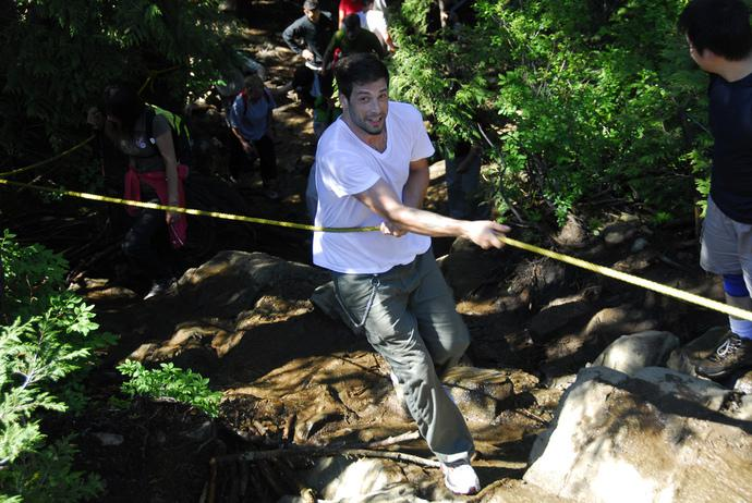 Using a rope to help climb the Grouse Grind