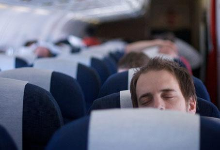 Sleeping on airplanes comfortably will be easier with Claire's tips.